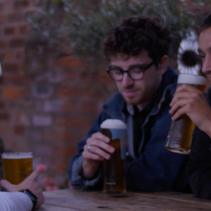 Lads have a pint at the pub