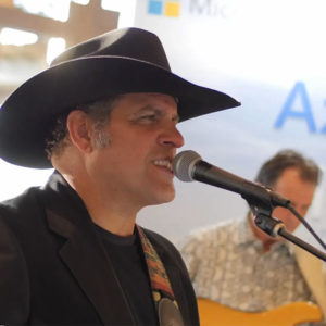 Man singing at Symphony AI event