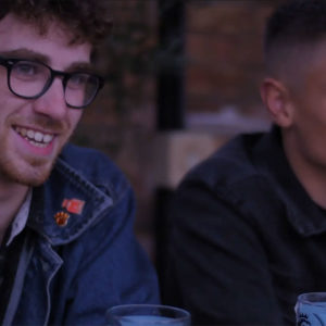 Two lads having a pint at the pub