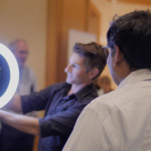 Man demonstrating a light product at Symphony AI event